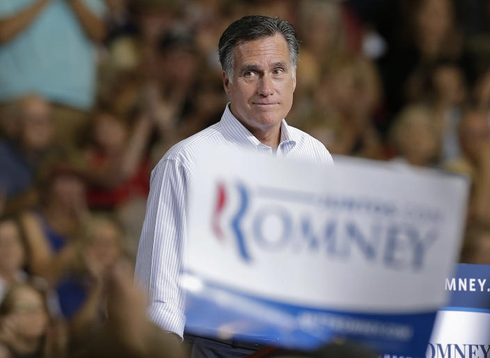 Republican presidential candidate and former Massachusetts Gov. Mitt Romney pauses as supporters cheer to remarks during a rally Friday, Sept. 21, 2012, in Las Vegas. (AP Photo/Julie Jacobson)