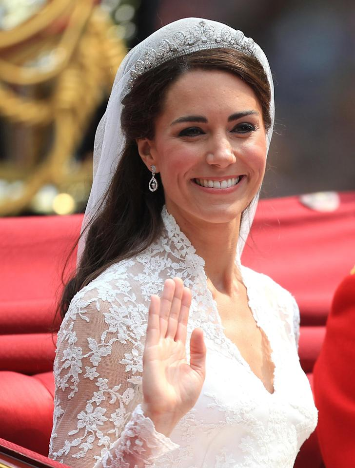 <p>Kate wore the Cartier Halo tiara with her Alexander McQueen bridal gown on her wedding day in 2011. Made by Cartier in 1936, the Halo tiara was an anniversary present from King George VI to the Queen Mother. She passed it down to her daughter the Queen on her 18th birthday (PA) </p>