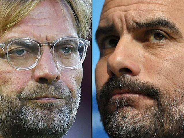 Jurgen Klopp and Pep Guardiola are battling for the Premier League title (AFP Photo/Oli SCARFF)