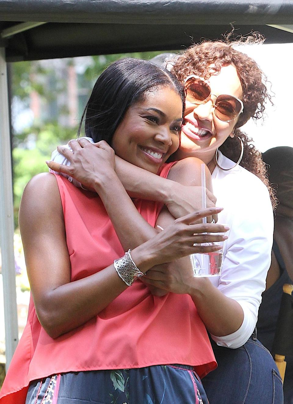 <p>Gabrielle Union and Lala Anthony embrace on the set of <em>The Perfect Find</em> on June 29 in Newark, New Jersey.</p>
