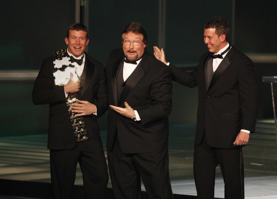 "FILE - In this March 27, 2010, file photo, WWE Superstar Ted DiBiase Jr., left, with brother Brett DiBiase, right, induct their father ""Million Dollar Man"" Ted DiBiase into the 2010 WWE Hall of Fame at the Ceremony in Phoenix, Ariz. The state of Mississippi gave more than $2.1 million in federal welfare money to a ministry run by former pro wrestler Ted DiBiase Sr. He was known in the ring as ""The Million Dollar Man"" and is the father of a Brett, who was recently indicted on charges of embezzling federal welfare money from the state. (Rick Scuteri/AP Images for WWE, File)"