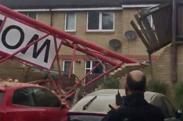 People Trapped After Crane Collapses Onto House In Bow, East London