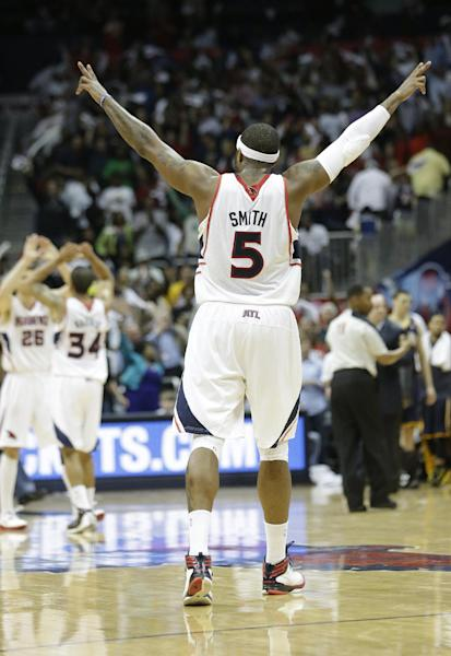 Atlanta Hawks small forward Josh Smith (5) reacts in the closing seconds during the second half in Game 4 of their first-round NBA basketball playoff series game against the Indiana Pacers, Monday, April 29, 2013 in Atlanta. Atlanta won 102-91 to even the series at 2-2. (AP Photo/John Bazemore)