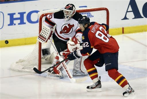 New Jersey Devils' goalie Martin Brodeur (30) and Florida Panthers' Tomas Kopecky (82) wait for a puck during the third period of Game 7 in a first-round NHL Stanley Cup playoff hockey series in Sunrise, Fla., Thursday, April 26, 2012. The Devils won 3-2. (AP Photo/J Pat Carter)