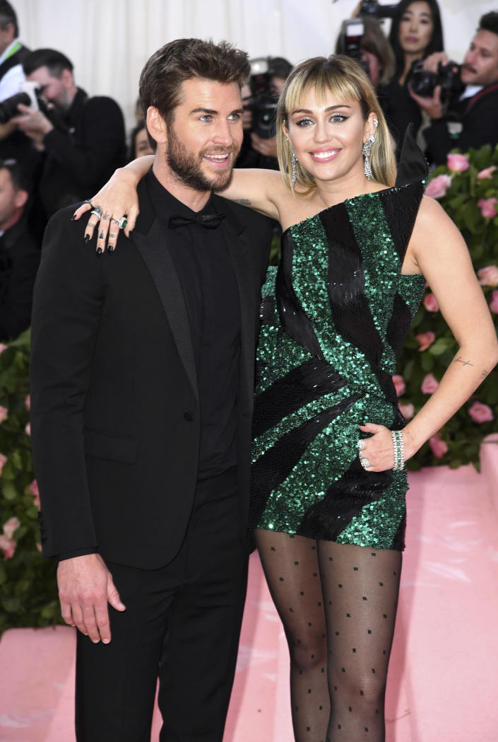 """Photo by: Doug Peters/STAR MAX/IPx 2019 8/10/19 Miley Cyrus and Liam Hemsworth split after less than a year of marriage. STAR MAX File Photo: 5/6/19 Liam Hemsworth and Miley Cyrus at the 2019 Costume Institute Benefit Gala celebrating the opening of """"Camp: Notes on Fashion"""". (The Metropolitan Museum of Art, NYC)"""
