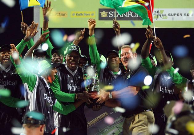 ST. JOHN'S, ANTIGUA AND BARBUDA - NOVEMBER 01:  BER 01:  Sir Allen Stanford presents the trophy to Superstars captain Chris Gayle during the Stanford Twenty20 Super Series 20/20 for 20 match between Stamford Superstars and England at the Stanford Cricket Ground on November 1, 2008 in St Johns, Antigua  (Photo by Tom Shaw/Getty Images)