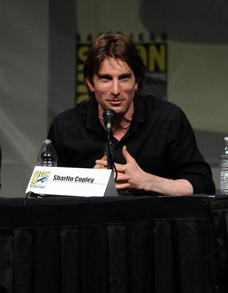 "SAN DIEGO, CA - JULY 13:  Actor Sharlto Copley speaks during Sony's ""Eylsium"" panel during Comic-Con International 2012 at San Diego Convention Center on July 13, 2012 in San Diego, California.  (Photo by Kevin Winter/Getty Images)"