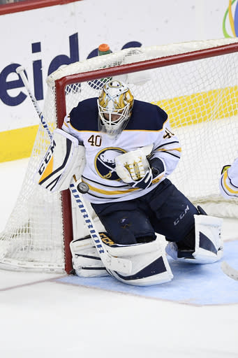 Buffalo Sabres goaltender Carter Hutton (40) stops the puck during the third period of an NHL hockey game against the Washington Capitals, Saturday, Dec. 15, 2018, in Washington. (AP Photo/Nick Wass)