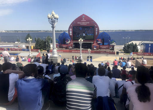 People watch the match between France and Australia at the Fan Fest on the bank of the river Wolga during the 2018 soccer World Cup in Volgograd, Russia, Friday, June 8, 2018. (AP Photo/Rob Harris)