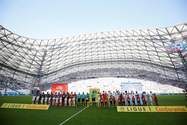 Soccer Football - Ligue 1 - Olympique de Marseille vs LOSC Lille - Orange Velodrome, Marseille, France - April 21, 2018 General view of players and officials lined up before the match REUTERS/Philippe Laurenson