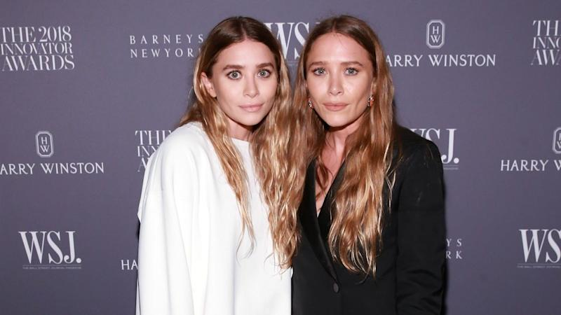 Mary-Kate and Ashley Olsen Step Out in Contrasting Colors for Rare Red Carpet Appearance