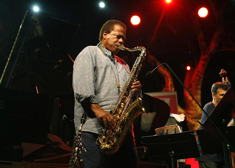 """FILE - This July 23, 2013 file photo shows jazz saxophonist Wayne Shorter performing at the 5 Continents Jazz Festival, in Marseille , southern France. Shorter and composer-arranger Maria Schneider are each triple winners in the 2014 Jazz Awards presented by the Jazz Journalists Association. Shorter won for musician of the year, best album (""""Without A Net""""), and top midsize ensemble. (AP Photo/Claude Paris, File)"""