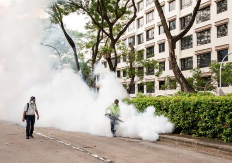 NEA officers conducting fogging at the Woodleigh Close dengue cluster. (PHOTO: National Environment Agency)