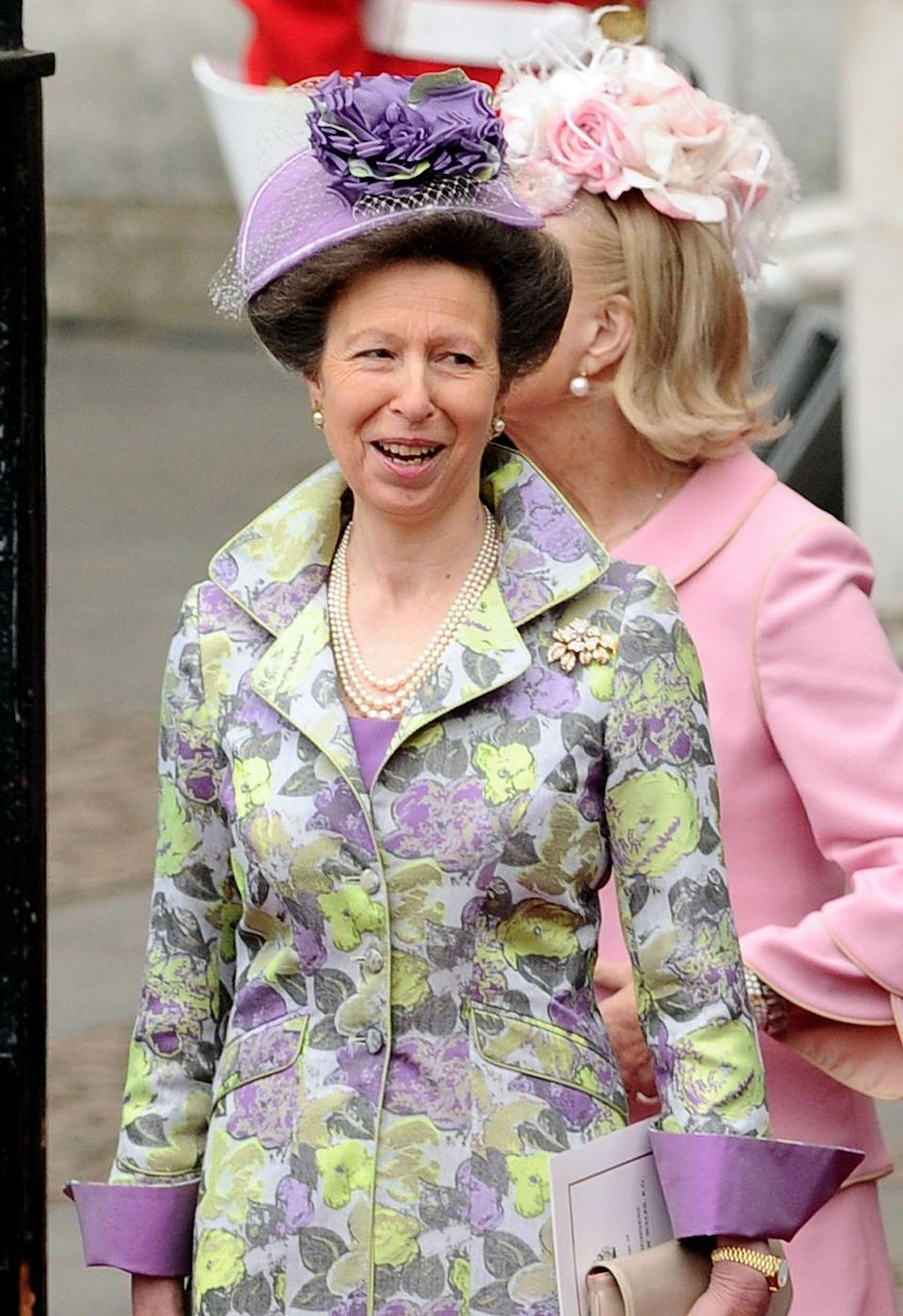 <p>Princess Anne celebrates the wedding of Prince William and Duchess Kate in a purple floral design.</p>
