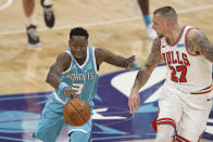 Charlotte Hornets guard Terry Rozier, left, pushes the ball upcourt against Chicago Bulls center Daniel Theis during the first half of an NBA basketball game in Charlotte, N.C., Thursday, May 6, 2021. (AP Photo/Nell Redmond)