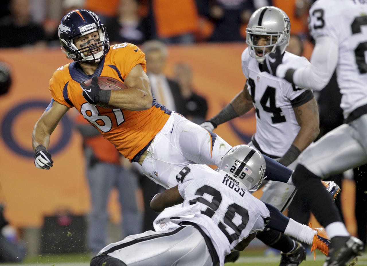 Denver Broncos wide receiver Eric Decker (87) is tackled by Oakland Raiders cornerback Brandian Ross (29) after gaining a first down in the second quarter of an NFL football game, Monday, Sept. 23, 2013, in Denver. (AP Photo/Joe Mahoney)