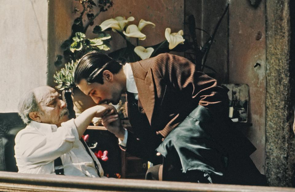 SICILY, ITALY - 1974: Giuseppe Sillato and Robert De Niro perform a scene in The Godfather Part II directed by Francis Ford Coppola in 1974 in Sicily, Italy.  (Photo by Michael Ochs Archive/Getty Images)