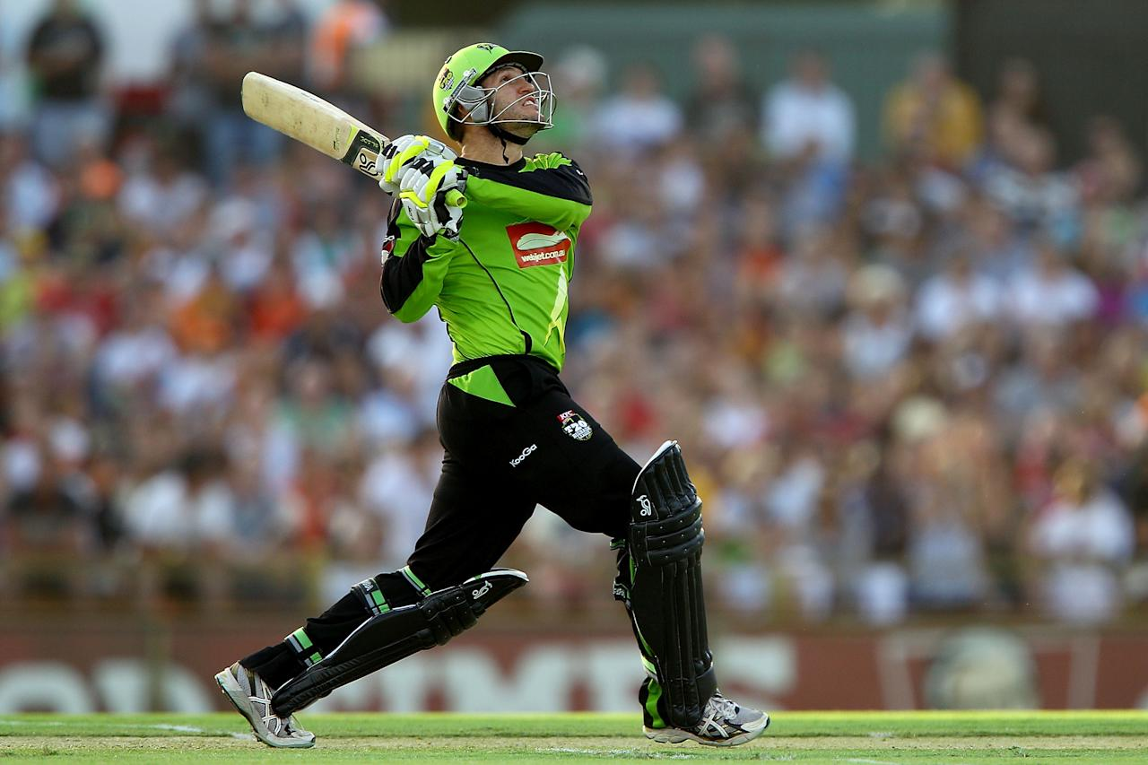 PERTH, AUSTRALIA - JANUARY 04:  Simon Keen of the Thunder hits out  during the Big Bash League match between the Perth Scorchers and the Sydney Thunder at WACA on January 4, 2013 in Perth, Australia.  (Photo by Paul Kane/Getty Images)