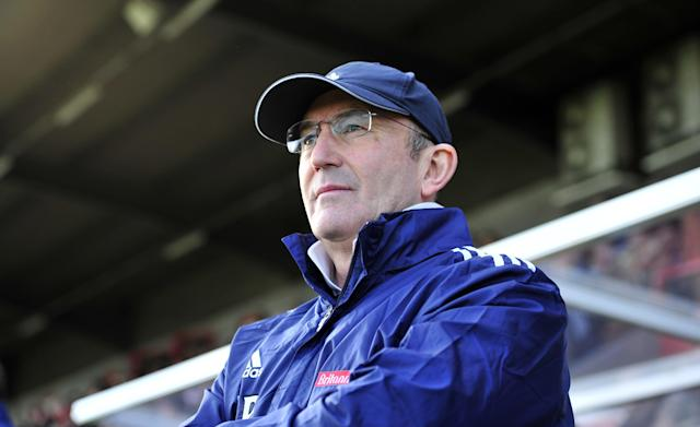 "Stoke City's Welsh manager Tony Pulis looks on before the FA Cup fifth round football match against Crawley Town at Broadfield Stadium in Crawley on February 19, 2012. AFP PHOTO/GLYN KIRK RESTRICTED TO EDITORIAL USE. No use with unauthorized audio, video, data, fixture lists, club/league logos or ""live"" services. Online in-match use limited to 45 images, no video emulation. No use in betting, games or single club/league/player publications (Photo credit should read GLYN KIRK/AFP/Getty Images)"