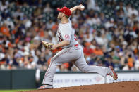Los Angeles Angels starting pitcher Dylan Bundy (37) throws against the Houston Astros during the first inning of a baseball game Sunday, April 25, 2021, in Houston. (AP Photo/Michael Wyke)