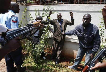 Policemen search a man for weapons as he walked out of Westgate Shopping Centre in Nairobi September 21, 2013. REUTERS/Goran Tomasevic