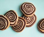 """<p>Here's a cookie that looks like it took hours to make but in fact are super easy to make. By taking two different kinds of dough you simply slice stacked strips and bake them into festive pinwheel cookies. <a href=""""https://www.yahoo.com/food/chocolatevanilla-bean-pinwheels-127738509965.html"""" data-ylk=""""slk:Get the Chocolate–Vanilla Bean Pinwheels recipe.;outcm:mb_qualified_link;_E:mb_qualified_link;ct:story;"""" class=""""link rapid-noclick-resp yahoo-link""""><b>Get the Chocolate–Vanilla Bean Pinwheels recipe</b>.</a><i> (Photo: Charity Burggraaf)</i></p>"""