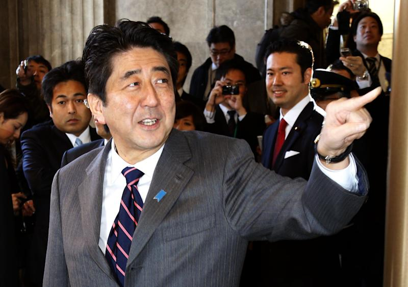 Japan's prime-minister-to-be Shinzo Abe arrives at the parliament for the special diet session in Tokyo, Wednesday, Dec. 26, 2012. Capitalizing on the Democrats' failure to improve the economy and its perceived lack of strong leadership, Abe led the Liberal Democratic Party to victory in parliamentary elections Dec. 16. Abe was to be named prime minister later Wednesday. He was also prime minister in 2006-2007.  (AP Photo/Kyodo News) JAPAN OUT, MANDATORY CREDIT, NO LICENSING IN CHINA, HONG KONG, JAPAN, SOUTH KOREA AND FRANCE