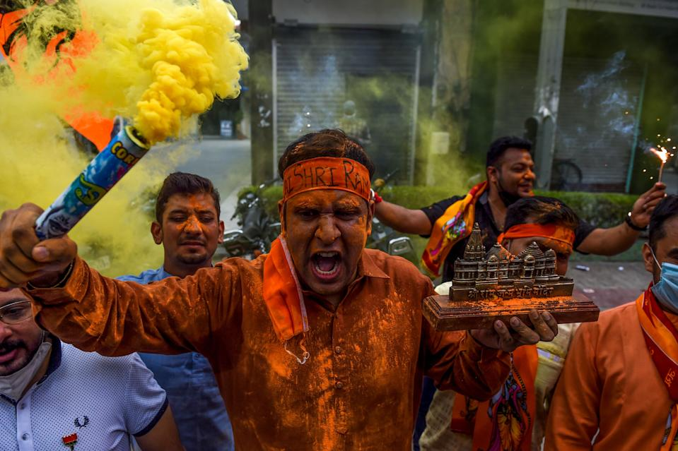 Bharatiya Janata Party (BJP) activists and supporters shout slogans as they celebrate before the groundbreaking ceremony of the Ram Temple in Ayodhaya, in New Delhi on August 5, 2020. - India's Prime Minister Narendra Modi will lay the foundation stone for a grand Hindu temple in a highly anticipated ceremony on August 5 at a holy site that was bitterly contested by Muslims, officials said. The Supreme Court ruled in November 2019 that a temple could be built in Ayodhya, where Hindu zealots demolished a 460-year-old mosque in 1992. (Photo by Money SHARMA / AFP) (Photo by MONEY SHARMA/AFP via Getty Images)