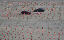 Vehicles drive around in opposite directions in a maze of traffic cones, as they enter the Dodgers Stadium vaccination site in Los Angeles Friday, April 2, 2021. California has administered nearly 19 million doses, and nearly 6.9 million people are fully vaccinated in a state with almost 40 million residents. But only people 50 and over are eligible statewide to get the vaccine now. Adults 16 and older won't be eligible until April 15. (AP Photo/Damian Dovarganes)