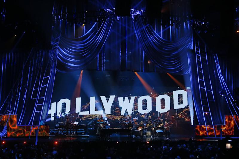 Randy Newman performs with Jackson Browne and John Fogerty before Newman was inducted into the Roack and Roll Hall of Fame during the Rock and Roll Hall of Fame Induction Ceremony at the Nokia Theatre on Thursday, April 18, 2013 in Los Angeles. (Photo by Danny Moloshok/Invision/AP)