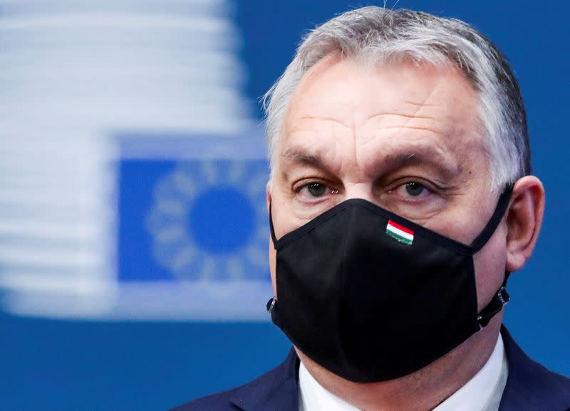FILE PHOTO: Hungary's Prime Minister Viktor Orban arrives for an EU summit in Brussels