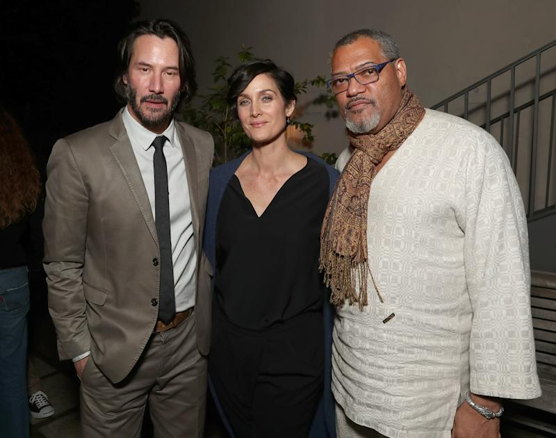 "HOLLYWOOD, CA - JANUARY 30: Keanu Reeves, Carrie-Anne Moss and Laurence Fishburne attend the after party for the premiere of Summit Entertainment's ""John Wick: Chapter Two""on January 30, 2017 in Hollywood, California. (Photo by Todd Williamson/Getty Images)"