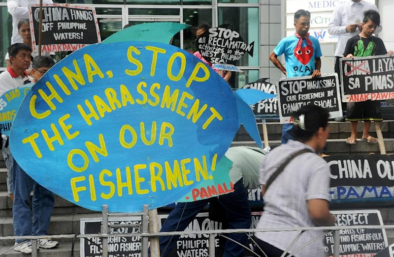 Activists rally outside the Chinese consulate in Manila on July 3, 2015 to protest China's reclamation works in the South China Sea and their harassment of Filipino fishermen (AFP Photo/Jay Directo)