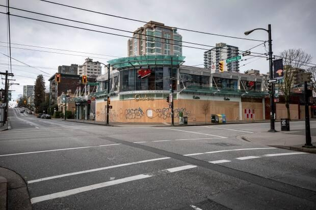Businesses boarded up on Robson street in Vancouver, British Columbia in March, 2020, when businesses were forced to close down at the start of the pandemic. (Ben Nelms/CBC - image credit)