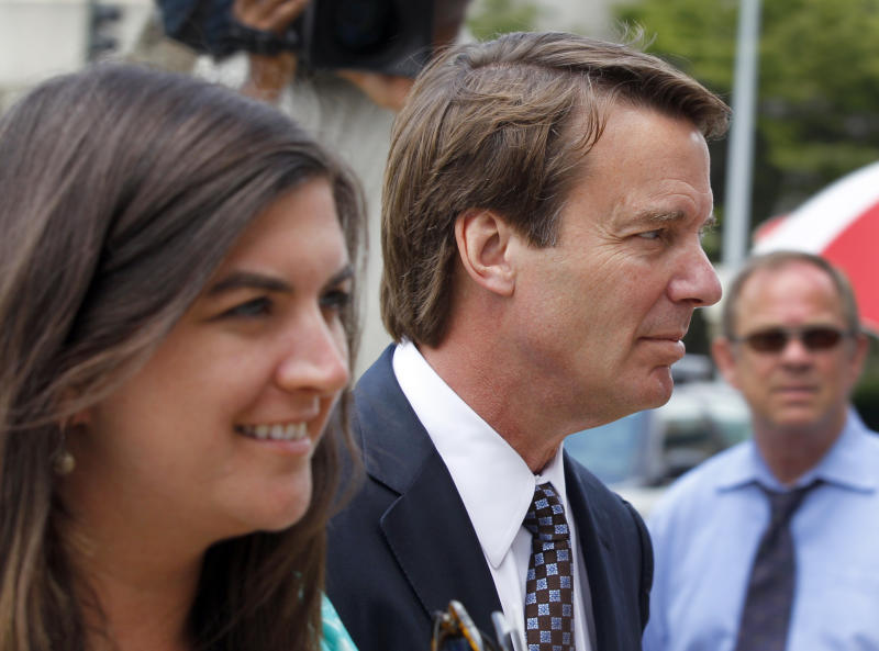 John Edwards, right, and his daughter Cate Edwards, left, arrive at a federal courthouse during the seventh day of jury deliberations in his trial on charges of campaign corruption in Greensboro, N.C., Tuesday, May 29, 2012. Edwards has pleaded not guilty to six counts related to campaign finance violations over nearly $1 million from two wealthy donors used to help hide the Democrat's pregnant mistress as he sought the White House in 2008. (AP Photo/Chuck Burton)