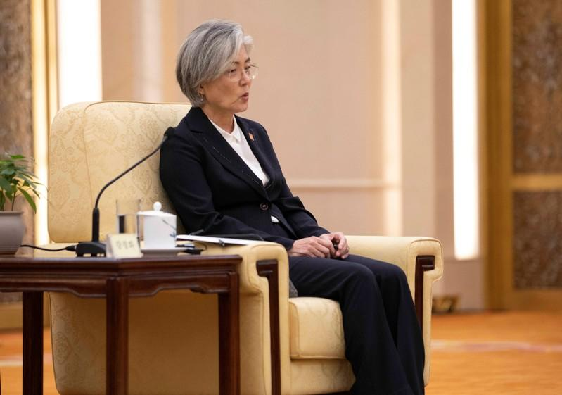 FILE PHOTO:  South Korean Foreign Minister Kang Kyung-wha speaks to Chinese  Premier Li Keqiang during their meeting with Japanese Foreign Minister Taro Kono (not pictured) at the Great Hall of the People (GHOP) in Beijing
