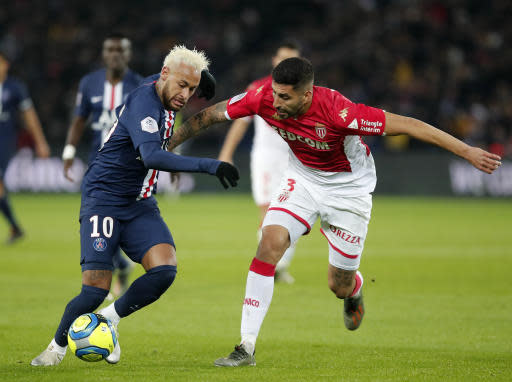 PSG's Neymar, left, is challenged by Monaco's Guillermo Maripan during the French League One soccer match between Paris-Saint-Germain and Monaco at the Parc des Princes stadium in Paris, Sunday Jan. 12, 2020. (AP Photo/Francois Mori)