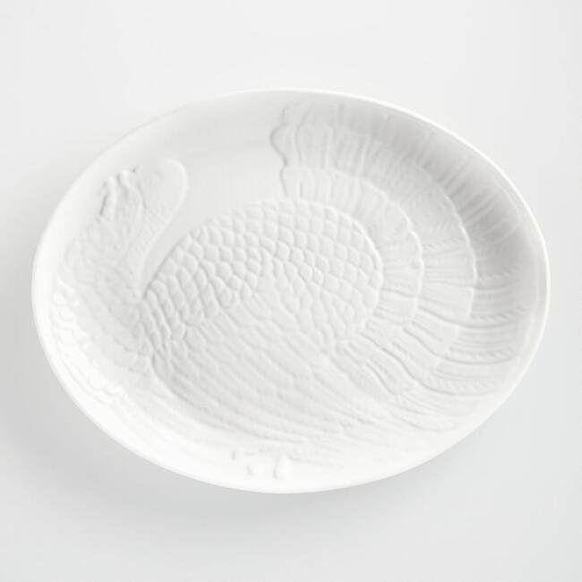 "This <a href=""https://www.worldmarket.com/product/white-oversized-turkey-platter.do?sortby=ourPicks&from=Search"" target=""_blank"">substantial turkey platter</a> accommodates everything from a Thanksgiving turkey to a Sunday roast."