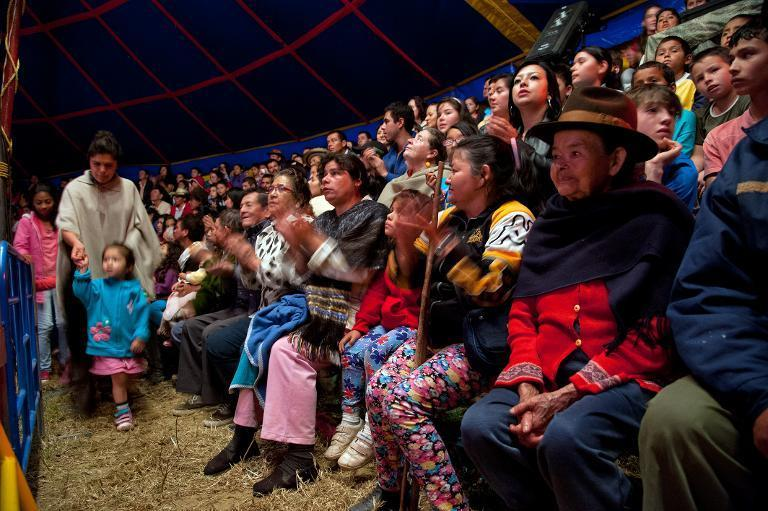 Local residents enjoy a show of the Army's Colombia Circus, in Tibirita, Cundinamarca department, on March 8, 2014