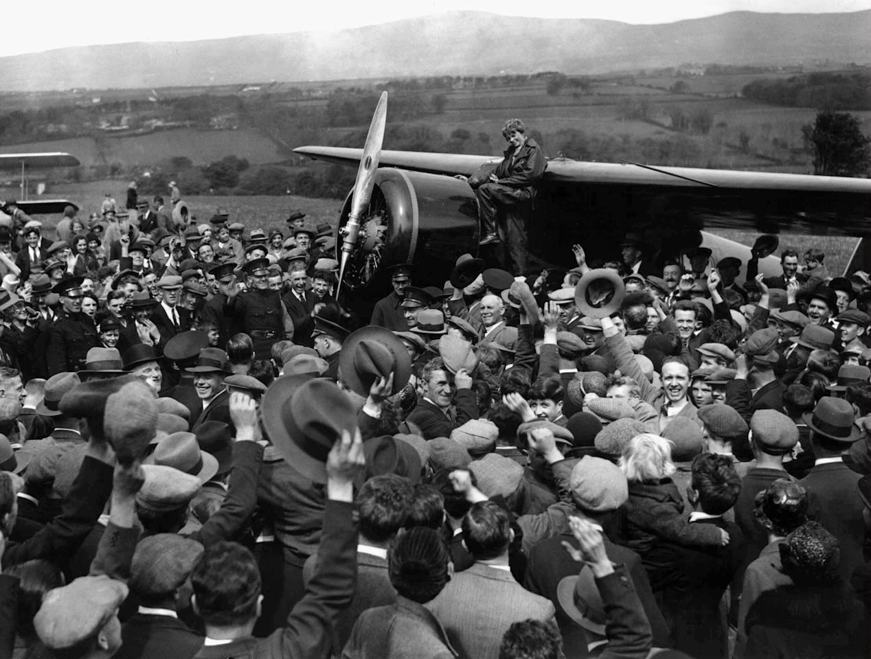 FILE - In this May 22, 1932 file photo, a crowd cheers Amelia Earhart as she boards her single-engine Lockheed Vega airplane in Londonderry, Northern Ireland, for the trip back to London. Three bone fragments found on a South Pacific island could help prove that Earhart died as a castaway after failing in her quest to circumnavigate the globe. Researchers told The Associated Press on Friday Dec. 17, 2010 that the University of Oklahoma hopes to extract DNA from bones found by a Delaware group dedicated to the recovery of historic aircraft. The fragments were recovered earlier this year on an uninhabited island about 1,800 miles south of Hawaii.