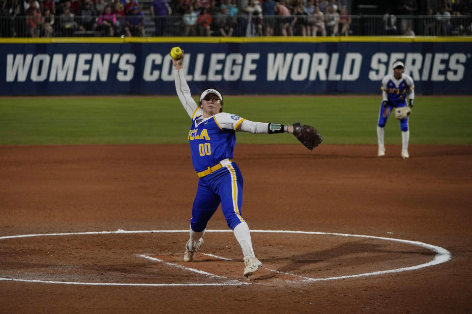 UCLA's Rachel Garcia pitches in the first inning of an NCAA Women's College World Series softball game against Alabama, Friday, June 4, 2021, in Oklahoma City. (AP Photo/Sue Ogrocki)