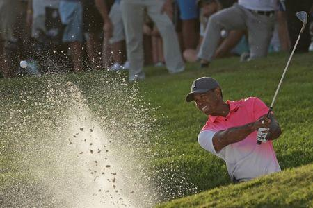 Feb 23, 2018; Palm Beach Gardens, FL, USA; Tiger Woods plays his shot from the bunker on the 18th during the second round of The Honda Classic golf tournament at PGA National (Champion). Mandatory Credit: Jasen Vinlove-USA TODAY Sports