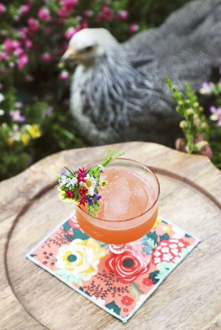 "<p>Pink grapefruit juice gives this fruity cocktail its bright, beautiful color. </p><p><strong><a href=""https://www.countryliving.com/food-drinks/a26870764/spring-bouquet-cocktail-recipe/"" rel=""nofollow noopener"" target=""_blank"" data-ylk=""slk:Get the recipe"" class=""link rapid-noclick-resp"">Get the recipe</a>.</strong></p>"