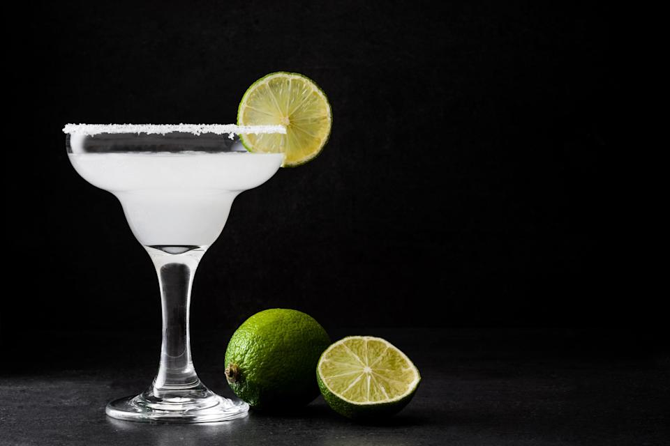 "Making this frozen margarita recipe is as easy as could be, but if it's a super-hot day, you may want to start by stashing your bottle of tequila in the freezer. <a href=""https://www.epicurious.com/recipes/food/views/frozen-margarita-200743?mbid=synd_yahoo_rss"" rel=""nofollow noopener"" target=""_blank"" data-ylk=""slk:See recipe."" class=""link rapid-noclick-resp"">See recipe.</a>"