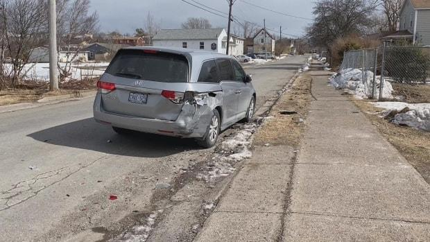 Police say Axworthy drove away in an unmarked police vehicle and hit this unoccupied van before deciding to abandon the vehicle.