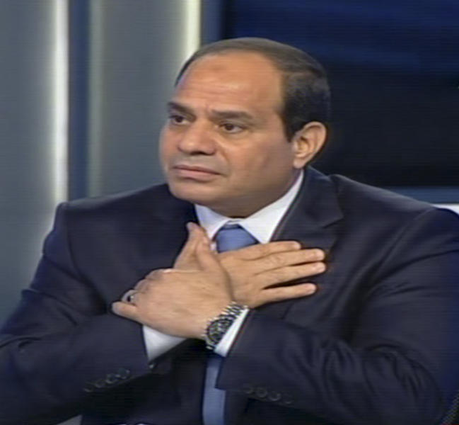 In this image made from video broadcast on Egypt's State Television, Egypt's retired Field Marshal Abdel-Fattah el-Sissi speaks during an interview in a nationally televised broadcast in Cairo, Egypt, Tuesday, May 6, 2014. In his campaign for president, Egypt's former army chief is casting himself as a strong-handed disciplinarian able to solve the nation's mounting problems and turmoil with good planning and efficiency, swinging between big-hearted shows of sympathy for Egyptians' woes and a military man's impatience with dissent. (AP Photo/Egypt's State Television)