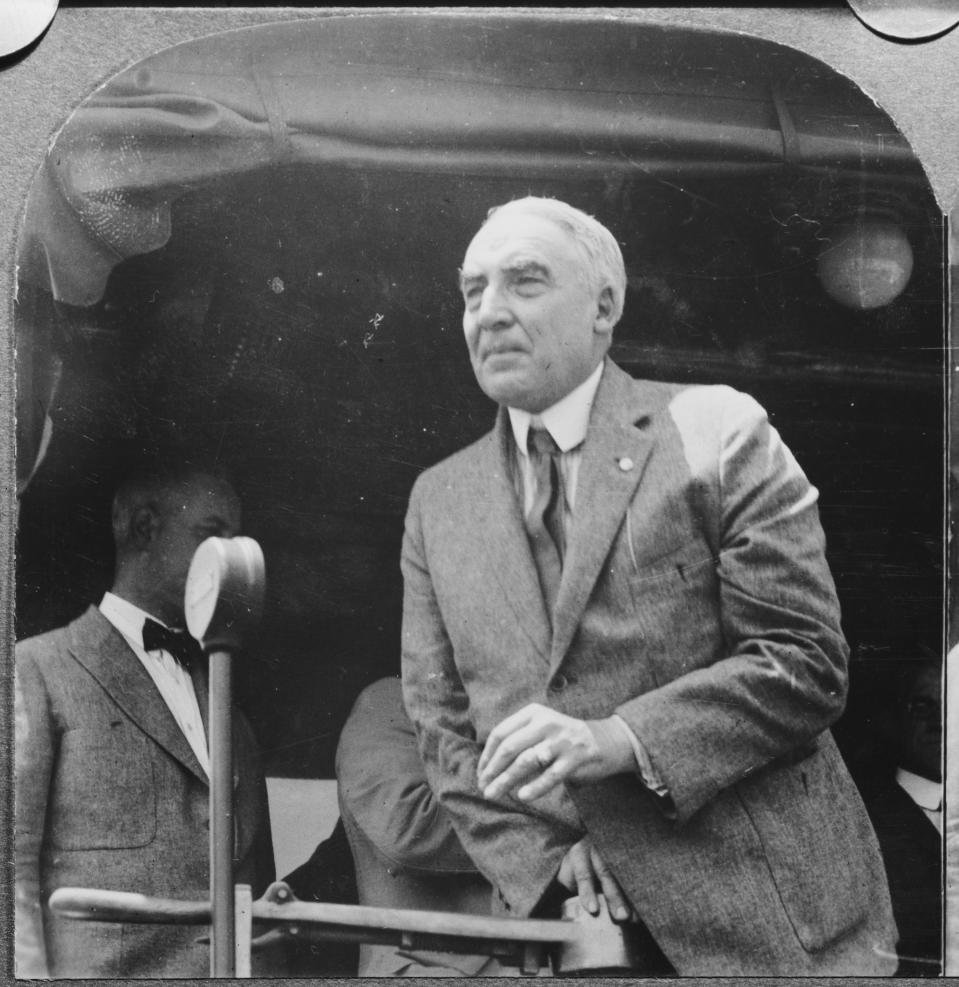 US President Warren G Harding (1865 - 1923) makes a speech at Martinsburg, West Virginia, during his 'Voyage of Understanding' trip to Alaska, July 1923. He is discussing the welfare of the nation from the presidential train. (Photo by Keystone View Company/Archive Photos/Getty Images)