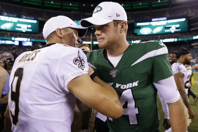 New Orleans Saints quarterback Drew Brees (9) greets New York Jets quarterback Sam Darnold after a preseason NFL football game Saturday, Aug. 24, 2019, in East Rutherford, N.J. The Saints won 28-13. (AP Photo/Adam Hunger)
