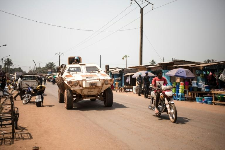 "Members of the UN peacekeeping mission in the Central African Republic (MINUSCA) are seen patrolling in Bangui in January 2020 -- UN Secretary General Antonio Guterres has said he sees ""progress"" on political reform, but more needs to be done"