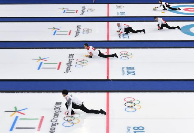 <p>Curlers practice and warm up on curling sheets ahead of session 9 of the Men's Round Robin. REUTERS/Toby Melville </p>